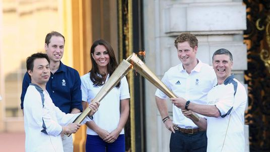 The Duke and Duchess of Cambridge and Prince Harry watch Wai-Ming hand over the London 2012 Olympic Torch