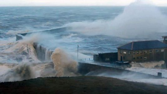 Waves batter the harbour wall at Whitehaven, Cumbria