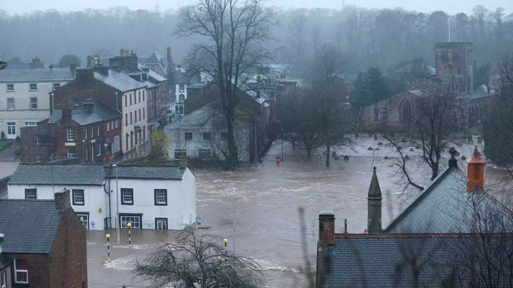 Flooded roads in Appleby, Cumbria, after Storm Desmond hit UK