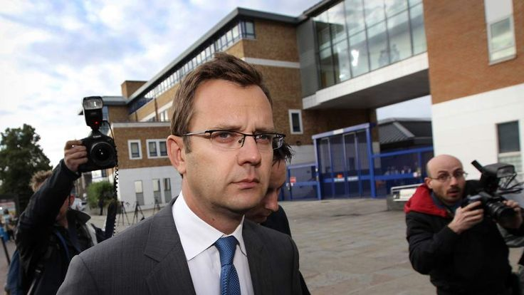 Andy Coulson is confronted by the media as he leaves Lewisham police station on July 8, 2011