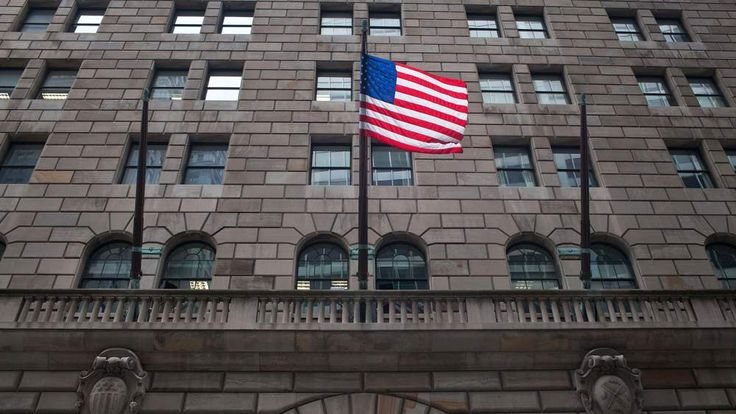 An United States flag flies over the entrance to the Federal Reserve Bank of New York, located at 33 Liberty Street, on July 29, 2011 in New York City.