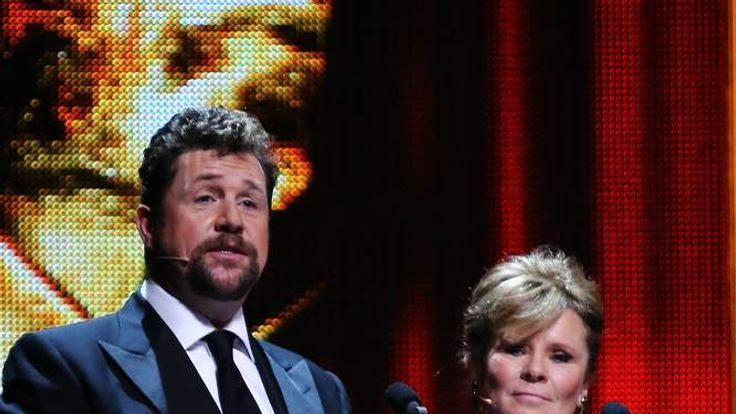 Co-hosts Michael Ball and Imelda Stauton speak on stage at the 2012 Olivier Awards