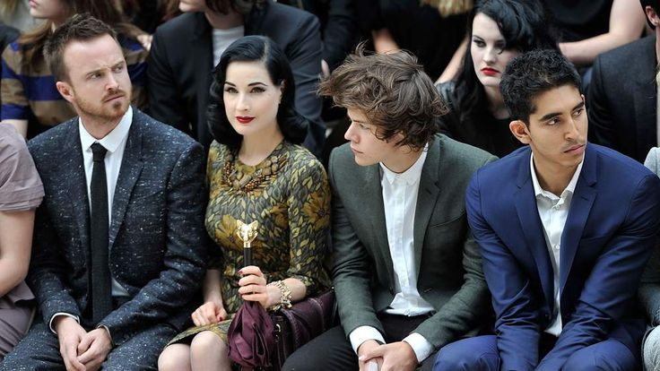 (L-R) Aaron Paul, Dita Von Teese, Harry Styles and Dev Patel attend the Burberry Spring Summer 2013 Womenswear Show