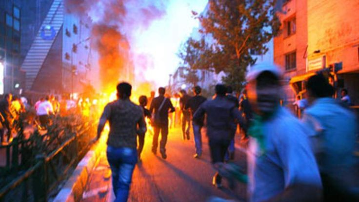 Supporters of defeated Iranian presidential candidate Mirhossein Mousavi run in the streets during protests in Tehran