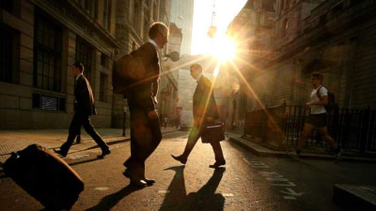 City Of London Bankers walking in the sun