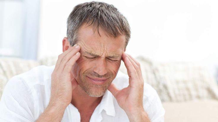 A man having a headache at home