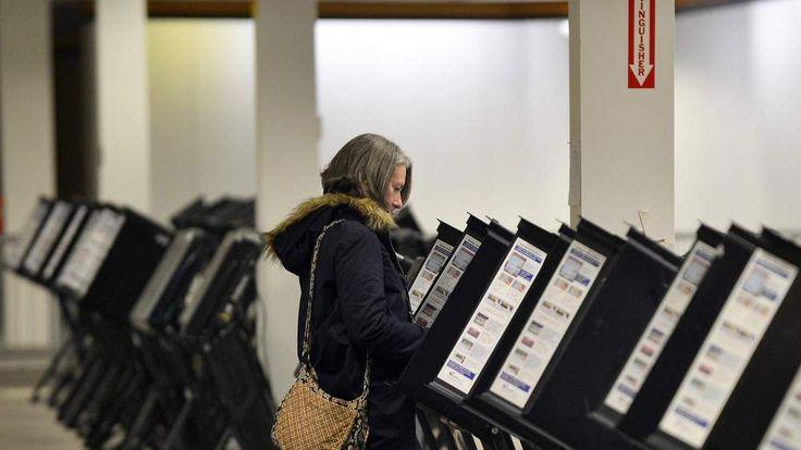 Female Voter Casts Ballot In Columbus Ohio