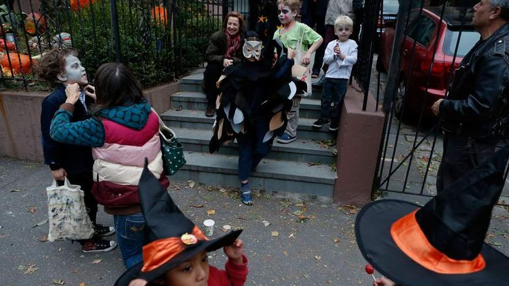 Child goes trick or treating for Halloween