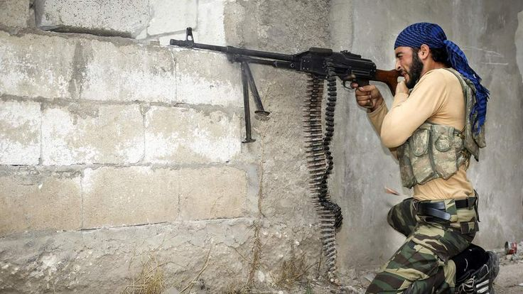 Syria: Rebel fighter fires machine gun at government troops in Harem