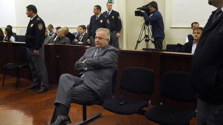Croatian ex-prime minister Ivo Sanader (C) sits in a court in Zagreb, on November 20, 2012.