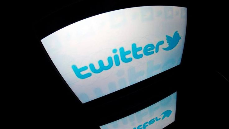Twitter logo reflected on a tablet screen