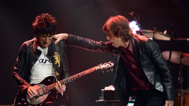 Ronnie Wood and Mick Jagger on stage in December 2012