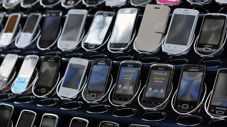 HTC handsets are displayed in a mobile phone shop
