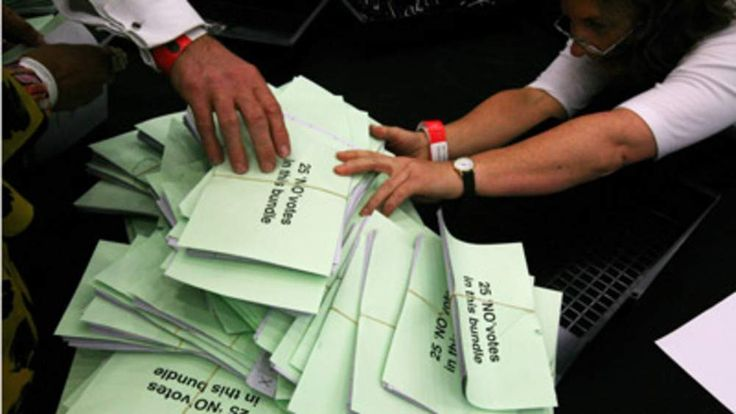 Ballot papers are sorted for the national referendum on the alternative vote system at Manchester Central