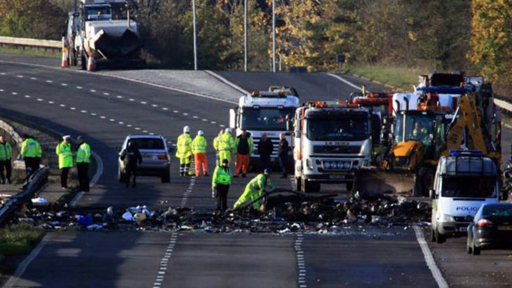 Police search through the remaining debris on M5
