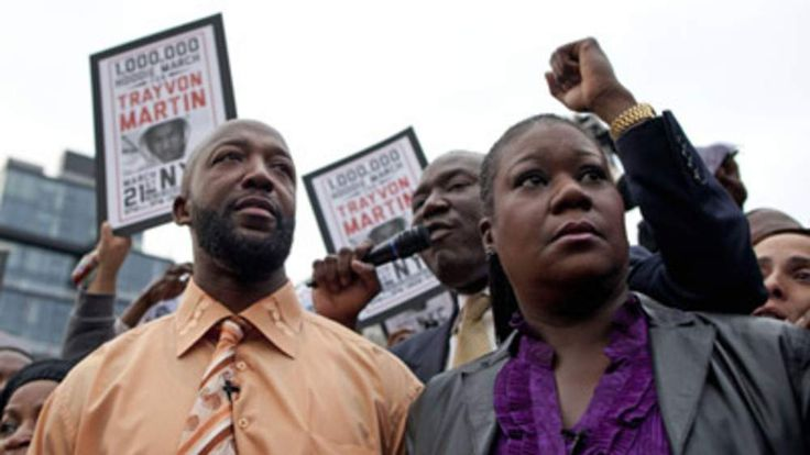 Tracy Martin (L), father of killed Florida teen Trayvon Martin, and Sybrina Fulton, the boy's mother