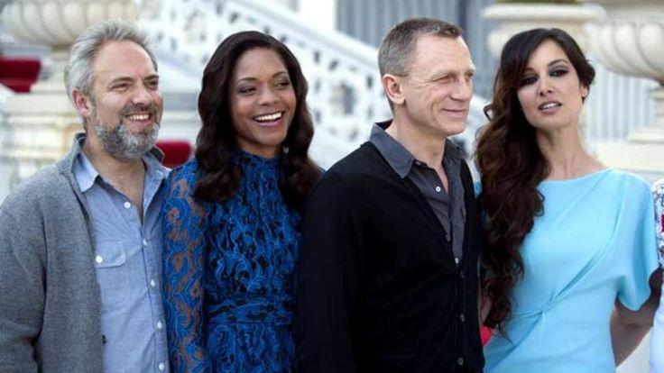 From left, Sam Mendes, Naomie Harris, Daniel Craig and Berenice Marlohe