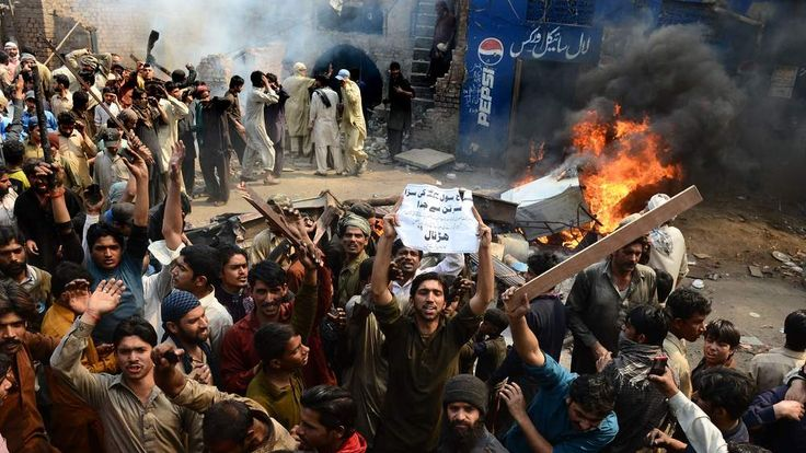 Pakistan demonstrators shouting slogans during a protest over alleged blasphemous remarks by a Christian.