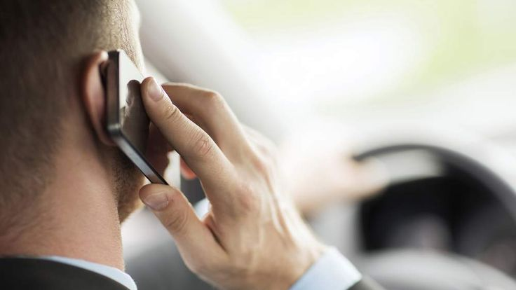 Man Driving Using Mobile Phone