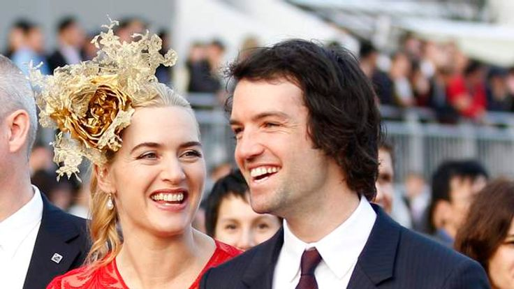 British actress Winslet and her boyfriend Rocknroll attend a promotional event for the Hong Kong international races in Hong Kong