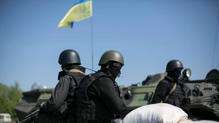 Ukrainian security personnel man a checkpoint near the town of Slaviansk