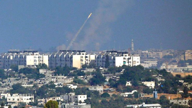 Smoke trail is seen as a rocket is launched towards Israel from the northern Gaza Strip
