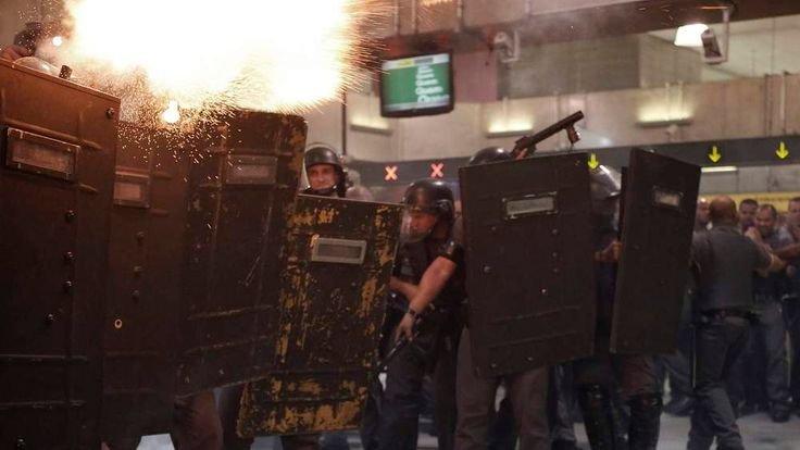 Riot police fire tear gas at demonstrators inside Faria Lima subway station during a protest against fare hikes for city buses, subway and trains in Sao Paulo