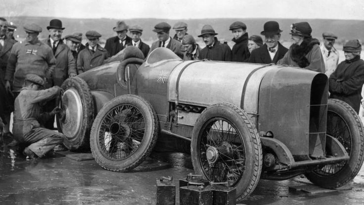 Sir Malcolm Campbell's Sunbeam motor car is fitted with new wheels at Pendine Sands