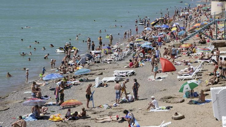 Beach in Ukraine packed with sunbathers