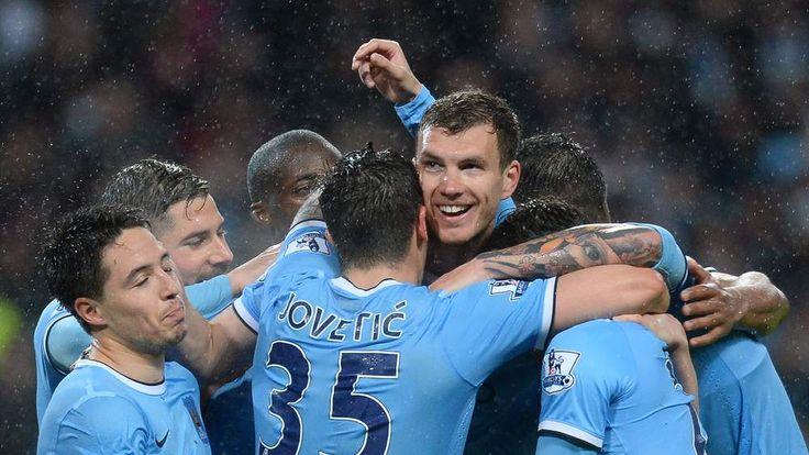 Manchester City's players celebrate during the match against Aston Villa.