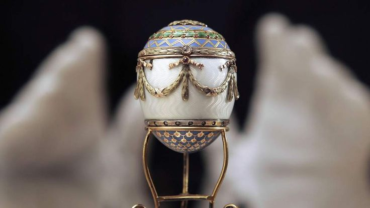 A Faberge enamel and two colour gold egg
