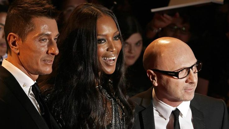The designers pose with Naomi Campbell.
