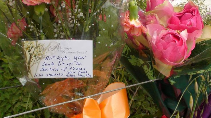 Flowers are left close to the scene