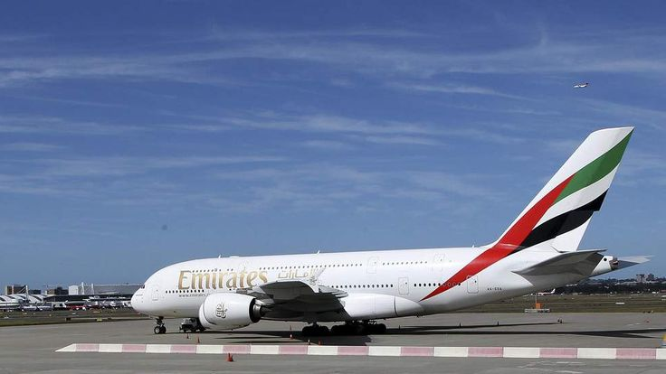 An Emirates A380 that suffered engine damage sits on the edge of the tarmac at Sydney international airport in Sydney, Australia