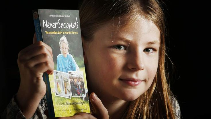 School dinner blogger Martha Payne with her book Never Seconds: The Incredible Story of Martha Payne during a photocall at the The Arches  in Glasgow