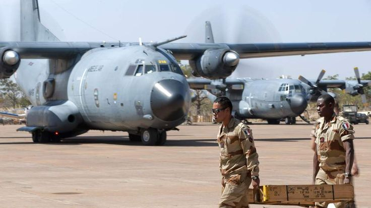French soldiers carrying ammunition at Bamako airport