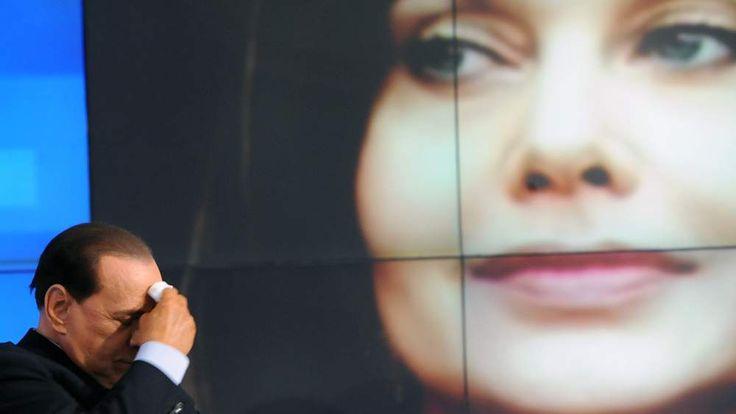 Ex-Italian Prime Minister Silvio Berlusconi and portrait of ex-wife Veronica Lario