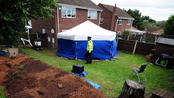 A police tent in the garden of the house in Mansfield