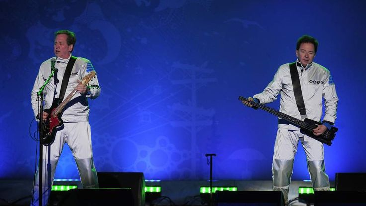 Bob Casale (L) and Gerald Casale (R) of the US group DEVO perform after a medal ceremony of the Vancouver 2010 Winter Olympics at Whistler Medal Plaza venue on February 22, 2010