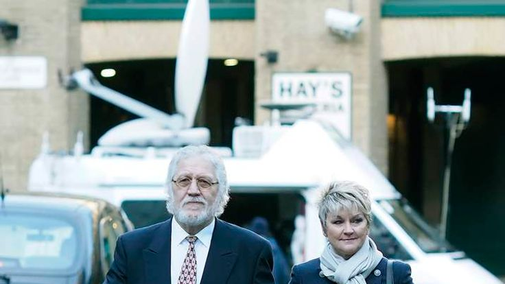 Dave Lee Travis arrives at court with wife Marianne