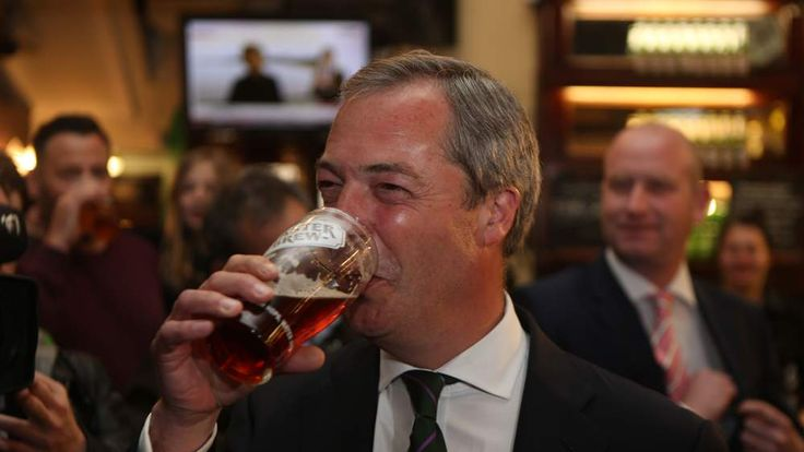 Ukip leader Nigel Farage has a pint in the Westminster Arms, London, as he celebrates his party's results in the polls