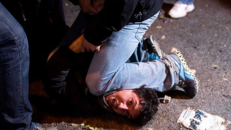 A protester is detained is Spain.