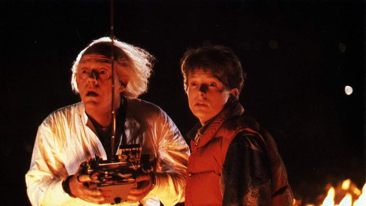 BACK TO THE FUTURE  1985 Universal/Steven Spielberg film with  Michael  Fox at right and Christopher Lloyd