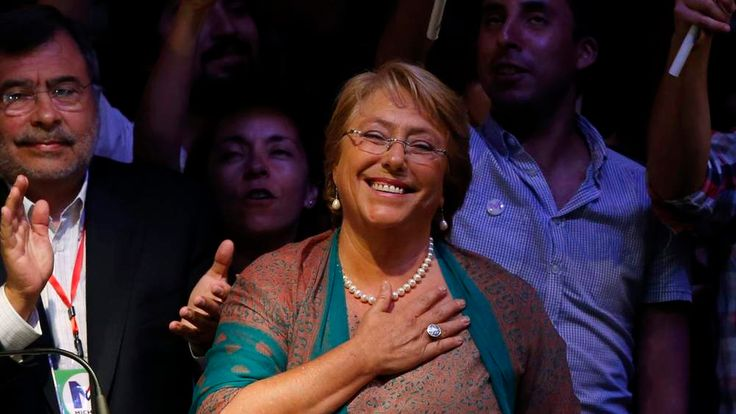 Michelle Bachelet celebrates after winning Chile's presidential elections
