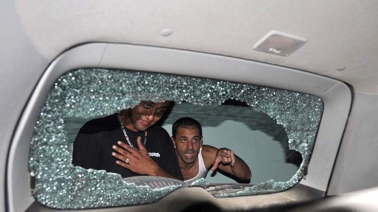 Car window allegedly shot out by Gisele Bundchen's bodyguards