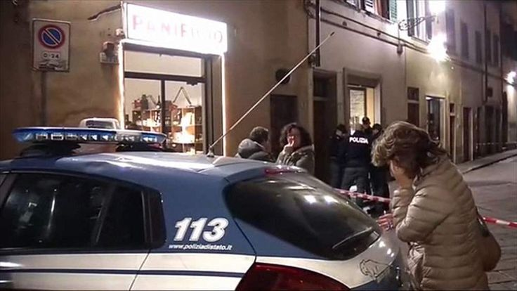 Police at the scene where an American woman was killed in Florence