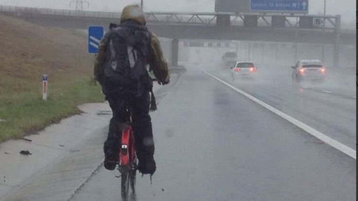 A cyclist on the M1 motorway