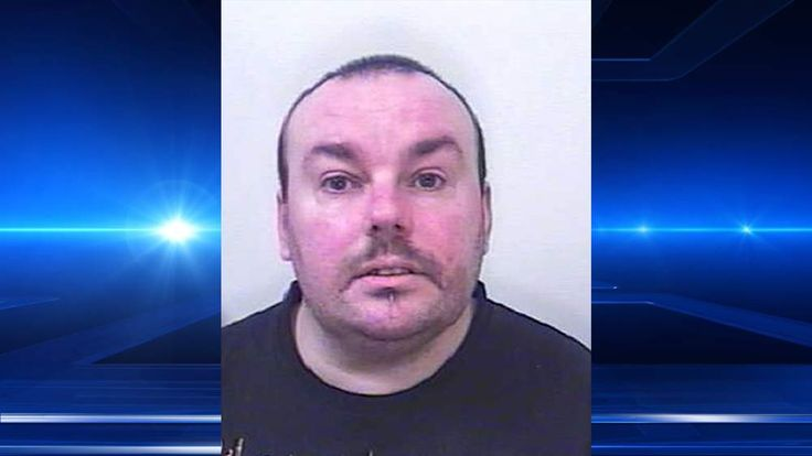 David Truscott, jailed for five years for threatening a family