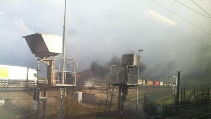 Car transporter in flames on Eurotunnel lorry shuttle train