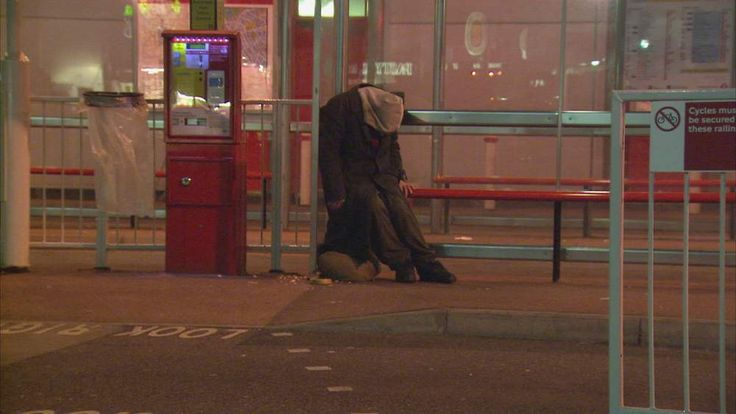 anonymous homeless person at bus stop